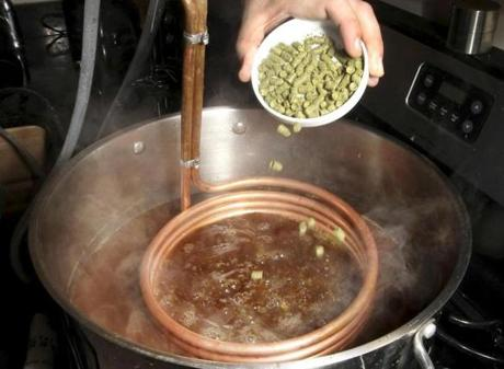 Hops, a flavoring and bittering agent, is added to the boiling pot.
